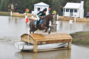Penny Johnson and 'BB Boom' make light work of the Wandin lake during their Horseland CCI **** cross country run.