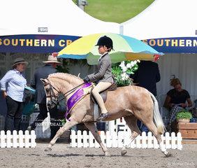 "Champion Small Show Hunter Pony winner on their victory lap - ""Kenda Park Strauss"" and Ella Warren."