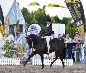 """Tia McKenzie and """"Rosedale Darlington"""" won the Child's Open Small Galloway Championship."""