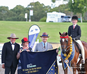 """Grand Champion Child's Open winner """"Argyl Fine Art"""" ridden by Ella Manning. Pictured with Ringmaster Dean Matthews and judges Shellley Riley and Michael Baker."""