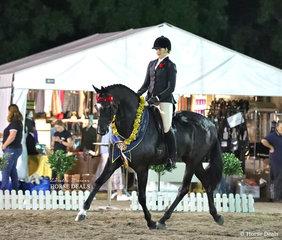 "The Jamala Lodge & Club Menangle Grand Champion Open Horse ""Warawee Impresareeo"" and Elizabeth Krog, as well as a gorgeous sash won a $1,000 cash prize."