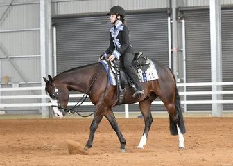 Tomi Elliott riding Let's Get Radicalous in the Youth Horsemanship.