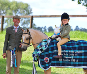 """The NSW RPSBS NSW Grand National Champion Show Hunter Leading Rein Pony """"Pant-y-Ffynon Cariad"""", owned and led by Luke Dawes, ridden by Harry Armistead."""