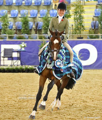 "The FRICKER FAMILY Grand National Champion Child's Show Hunter Hack ""Quantador"" and Arielle Stella."