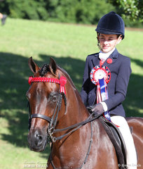 Claudia Hughes finished Top 10 in the LORELLE MERCER PHOTOGRAPHY Rider 12 & under 15 years event.