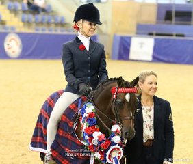 """The ROBBANIE STABLES Grand National Champion Small Pony """"Hibrie Sugar Plum"""" ridden by Trinette Crawford, owned by Emma Richardson. Pictured with sponsor Melanie Skinner."""