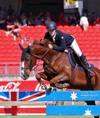 Sam Watson and 'Oaks Donatello' competing in the Young Riders Grand Prix.