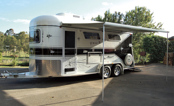 """The 2-Horse Angle Deluxe is 17.5' in length, 2.3m high and weighs 2.3 tonne. Bianca's float is 4"""" higher internally than normal at 7'6"""". <br> """"The Fiamma awning is wonderful. Not only can we sit in the shade of it, we can get the horses ready under it as well""""."""
