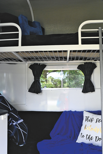 The two adult size bunks run along the right hand side (facing forward) of the float. Anthony has the top bunk from which he has a good view of the TV.