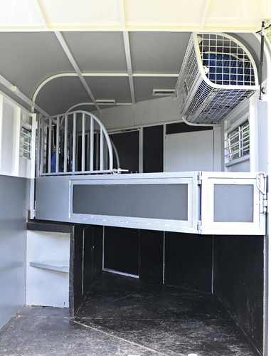 Two horses on the angle. Plenty of height for two big horses. The partitions are designed to fold back along the left hand side of the float whilst still being able to fully close up the back. The overhead rug rack is useful and the float boasts a heavy duty double floor.