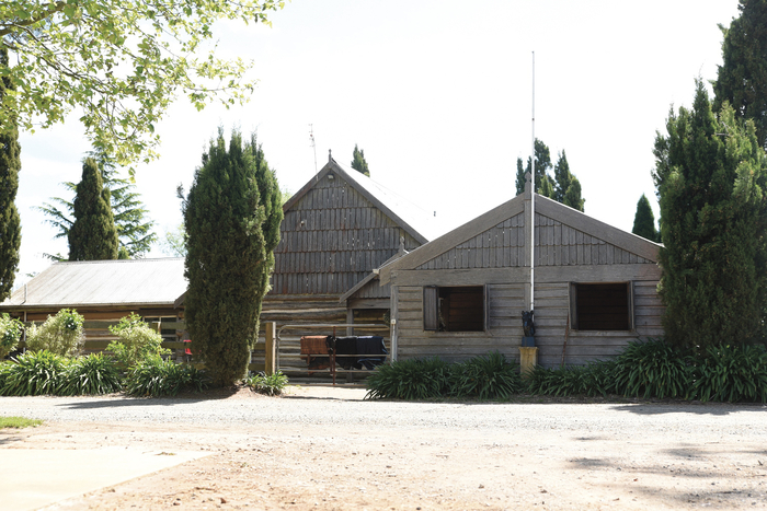 A back view of the old barn showing the two large boxes it contains.