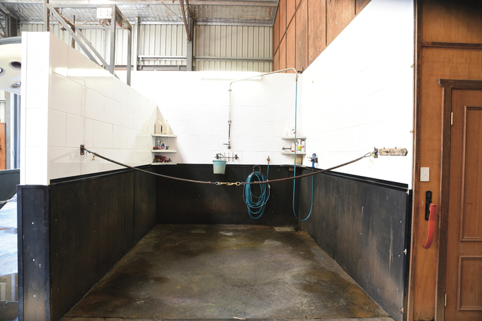 The rubber lined wash bay with cross ties and corner shelves.