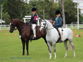 Champion Junior Rider Anastasia Blanch and Reserve Champion Ellie Willis