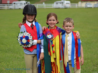 All smiles with Lots of ribbons from the beginner ring