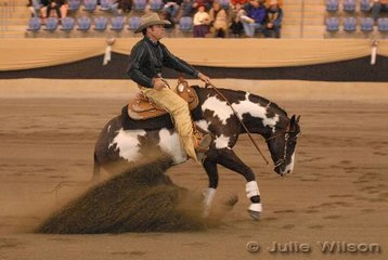 Warren Backhouse riding the colourful exhibit of C and J Marsh, Smoken Native Son to make the finals in the Open Futurity scoring 137 in the 1st Go-Round.