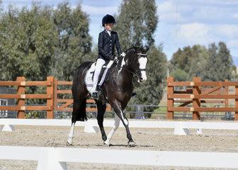Piper Kleinschmidt riding Daiquiri Laredo Moon in Youth Dressage.