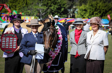 Supreme All breeds Brian Sheahan Memorial Glen Lee Ruby owned by the Govan family and pictured here with judges Glennis Miller, Gail Iskra and Marie Evans.