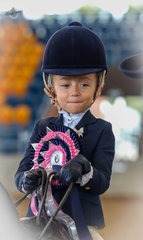 Champion Tiny Tot rider 3 and under 6 years, Georgia Gaspar, looking very pleased with her ride.