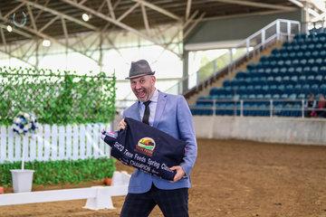 Ever dapper Greg Trembath, thoroughly enjoying his presentation duties to the winners