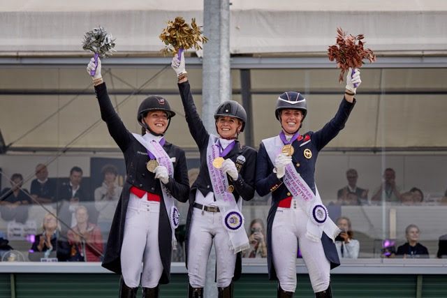 On the Freestyle podium at the FEI Dressage European Championship 2021 in Hagen, Germany today (L to R): Denmark's Cathrine Dufour (silver), Germany's Jessica von Bredow-Werndl (gold) and Great Britain's Charlotte Dujardin (bronze). (FEI/Liz Gregg)