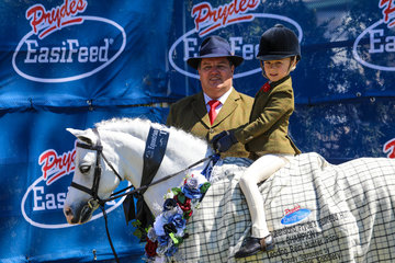 Bridie Raymont and  Nawarrah Park Belladonna with Paul Austin were the winners of the  Leading rein show hunter pony
