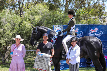 Mel Wallers Rueben Star ridden by Grace Berry for Champion childs large Hunter Hack with sponsor Phil Bobic from Universal stables