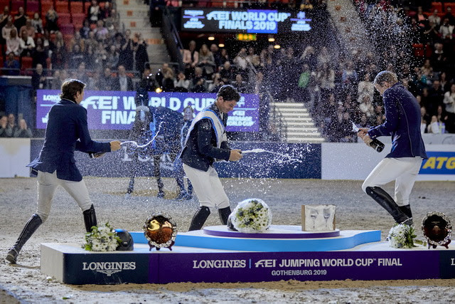 Champagne celebration for newly-crowned champion Steve Guerdat (centre), his Swiss compatriot and runner-up Martin Fuchs (left) and third-placed Peder Fredricson from Sweden (right) at the Longines FEI Jumping World Cup™ Final 2019 in Gothenburg (SWE). The Longines FEI Jumping World Cup™ Western European League 2021/2022 season gets underway this weekend at Oslo in Norway. (FEI/Liz Gregg)