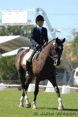 Susan Barton-Johnson rode Amana Valley Rococo in the Open Assoc. Prelim. to score 52.5%.