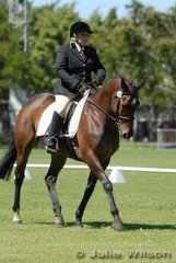 Kim Pass rode Ruby Tuesday in the Open Assoc. Novice to score 57.6%.
