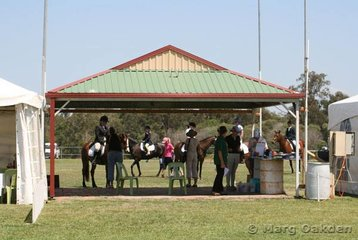 Looking through the announcer's pavillion to the warm-up area beyond at the 2006 Queensland Dressage Championships at Caboolture.
