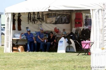 The girls from Horseland (the major sponsor of the 2006 Queensland Dressage Championships) enjoy the shade & a great view of the action in the comfort of their onsite trade display.