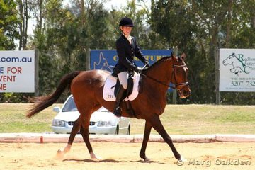 A happy Kimberley Boyd & the Thoroughbred gelding, The President (Deputy Governor x Wayward Wind), in the Preliminary 1.2 Division A.