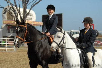 Two keen competitors in the District classes. Both from Geelong, L-R Katelyn Barratt riding 'Remy' and Rowie Matthews with 'Angel'.