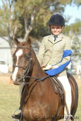Aaron Wood rode 'Bimbadeen Stirling' to win the District Boy Rider class 12-14 Years.