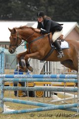 Charlotte Burn rode her 'Making Ground' in the C & D AM5 jumping competition on the first day of the Royal Geelong Show.