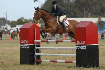Georgie Birrell rode her 'Pentonville Grove' to win the C & D AM5 jumping competition.
