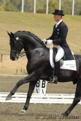 "Brett Parberry with Dr Kerry Mack's charismatic  Weltmeyer stallion, 'Whisper IV' in the Hamilton Island Grand Prix. Contesting their first National Championship Grand Prix title, Brett and 'Whisper IV"" were second with 64.12%."
