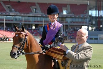 Brook Higgins from Toowoomba  was declared Champion Junior Girl Rider. She is seen here with Nick Gill presenting the Marj Holloway Trophy.