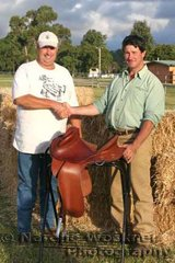 The successful winner of the Trophy Saddle valued at $2,500 donated by Southern Cross Saddlery of Deception Bay was Malcolm Adams presented the award by Kevin Petty from the Saddlery