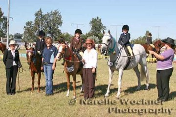 Winners lineup of Lead Rein riders 8yrs & under 1st Charlie Mitchell riding 'Bri-Jen Honeymead', 2nd Jade Rochford riding 'Hollydale Lady Guinevere', 3rd Mikayla MaCrae riding 'Palmgold Desert Flyte' with sponsor Katie Hill from Horseland Ipswich