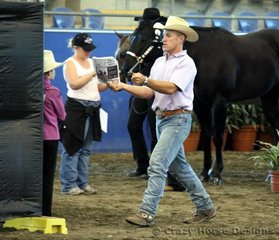 Gene Redwood shows his daughter the finer points in the showmanship walk-  it worked- she was awarded Reserve State Champion!