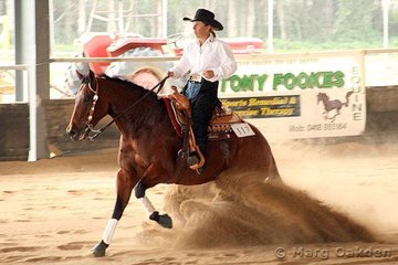 TJF Get Riled & Jill Fookes look to be enjoying their run in the Novice Horse Non-Pro Reining at the QRHA Championships.