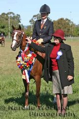 Champion Large Pony 2007 'Rathowen Scarlet Ribbons' ridden by Nina George with judge Nadine Asimus from Junee NSW