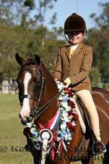 Champion Intermediate Show Hunter Pony 'Samson Serenade' exhibited by Katelyn Burgess