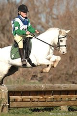 Kelsey Mull and 'Pixie' make a big leap to take fourth place in  Grade 4B for the Kergynyah Pony Club.