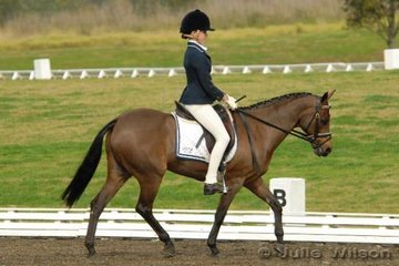 Christina Andrews rode her Riding Pony, Headley Park Blythe Spirit by Willowcroft Explorer for equql seventh place in the Internation Animal Health Pony  1.4 with 64.80%.