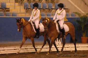 Tiffany Bignold riding Glo Brook Legend and Maddi Colquhoun with Congarinni Royal Sovereign had add an Elvis theme to their performance in the Young Rider Championship Pas De Deux.