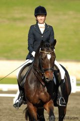 Megan Bryant rode Mayfield Cadence to 4th place in the Horze Australia Medium 4.3 with a score of 71.8%.