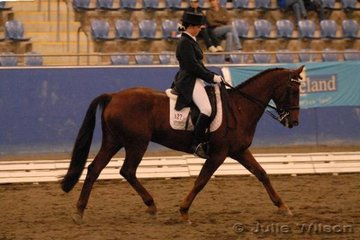 Melony Benson rode Storman Skies in the Australian Warmblood Horse Association FEI Young Rider Freestyle.