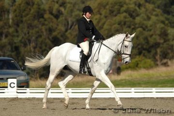 Fiona Hughes her white horse, Under The Weather in the Pre-Novice Division 2 and her black horse, Medicine Man in the Preliminary Division 2.